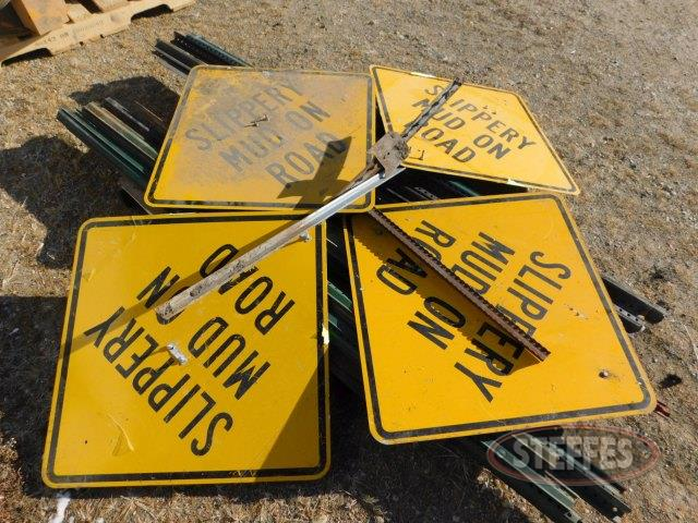 "(4) ""Slippery Mud on Road"" signs,"