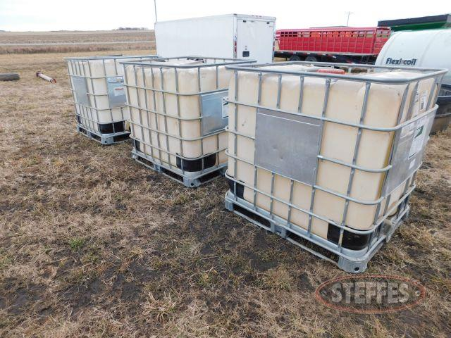 (3) 250 Gallon Chemical Tanks in Cages
