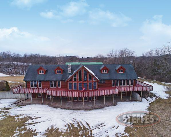 BEAUTIFUL LOG HOME ON 10 SURVEYED ACRES